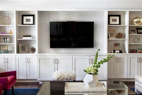 living room built in shelves gray trellis wallpaper on back of built ins transitional
