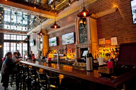 Newspaper Themed Bar | industrial themed bars liven up the nyc drink scene ny