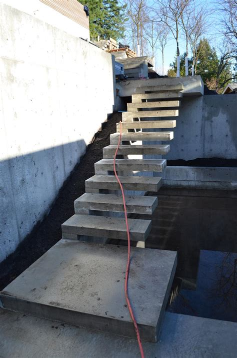 Exterior Concrete Cantilevered Stair Frontal concrete cantilevered stair at the building site concrete staircases and