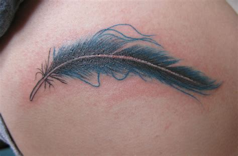feather with birds tattoo two birds of a feather flock together