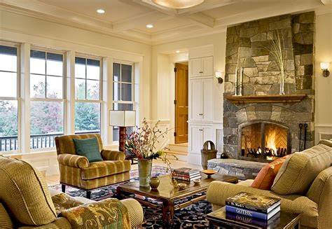stone fireplace and coffered ceiling create a cozy living room decoist