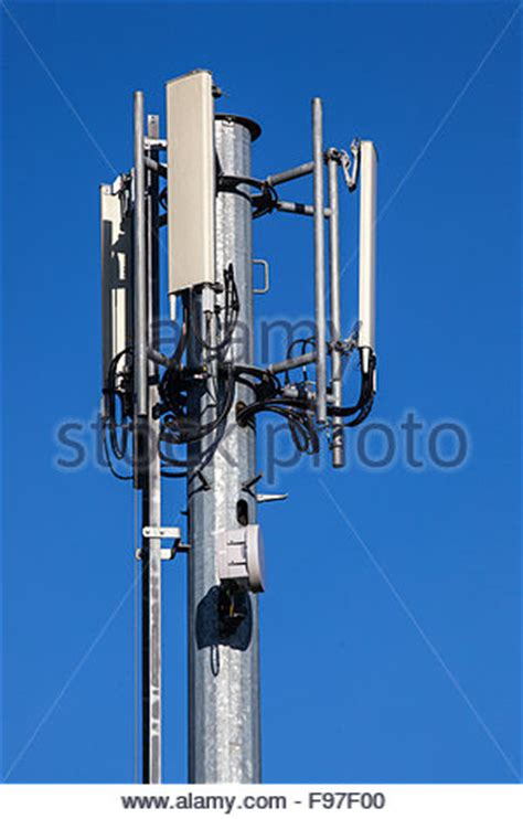 mobile cell phone radio transmission tower  microwave dishes stock photo royalty