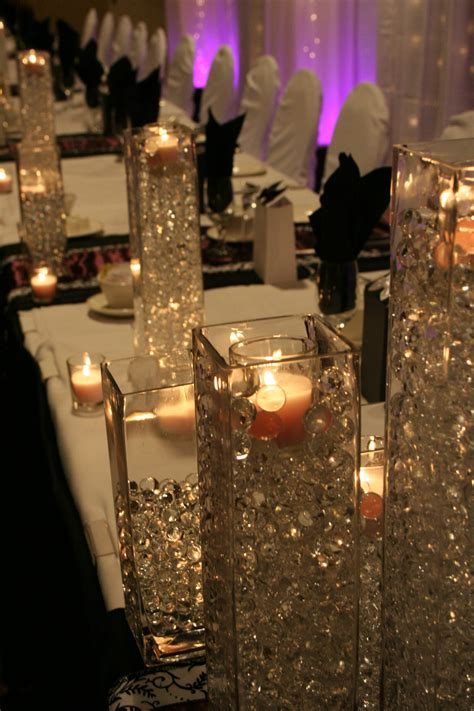 flowerless centerpieces vases filled with clear crystals