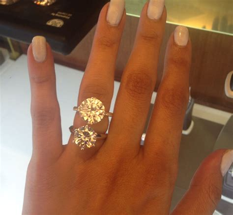 5 carat engagement ring on top and a 4 carat engagement