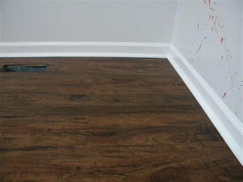 Vinyl Plank Floating Floor Over Tile In Kitchen