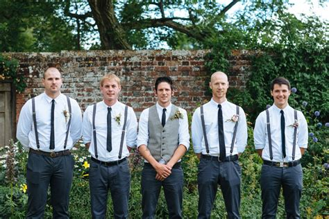 backyard wedding groom attire groom and groomsmen in navy pants and suspenders for