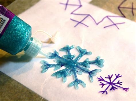 Paper And Glue Crafts - diy snowflakes with glitter glue use wax paper your
