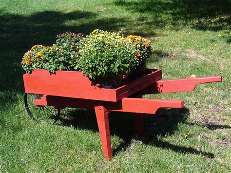 Wooden Wheelbarrow Planter by Decorative Wooden Wheelbarrow Planter Byegone Workshop