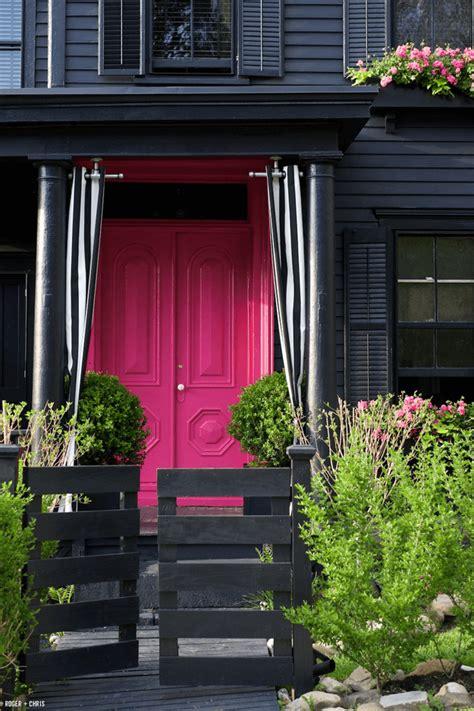 black home exterior with fuchsia pink doors pink bright pink pantone pink yarrow
