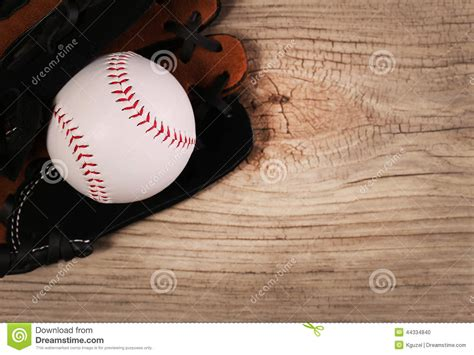space balls woodworking baseball in glove wood background stock photo