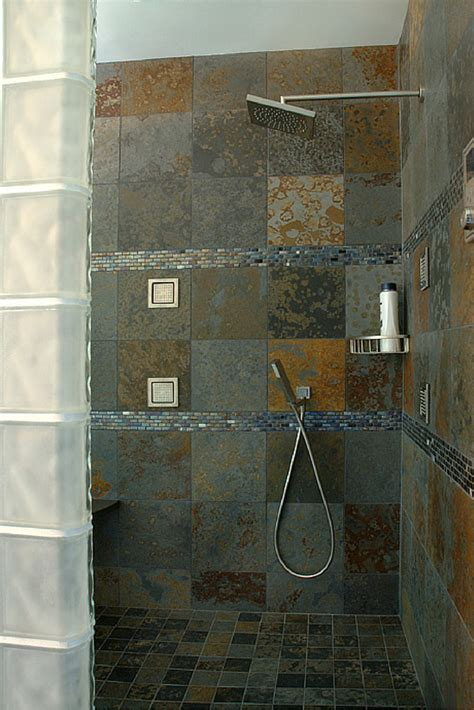 doorless curbless tile shower with river rock floor and advantages and disadvantages of a curbless walk in shower
