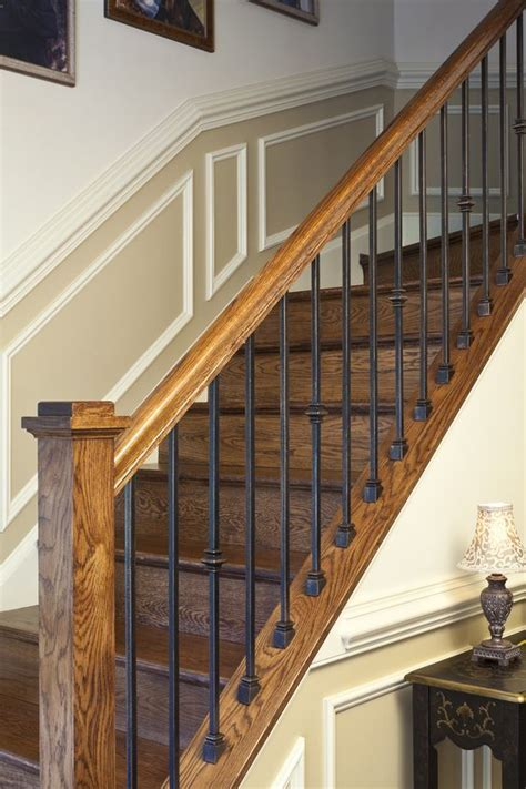 premade banister custom fabricated wrought iron spindles with stained rail