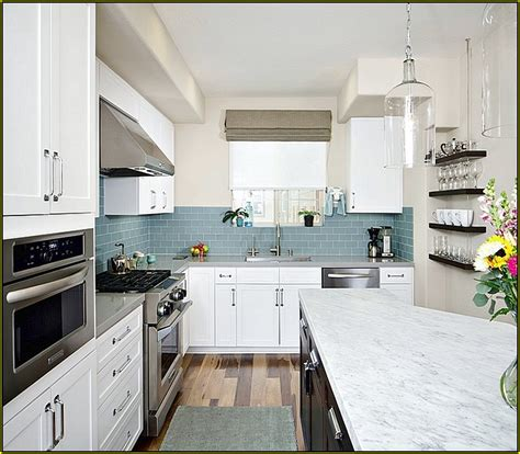 light blue glass subway tile backsplash