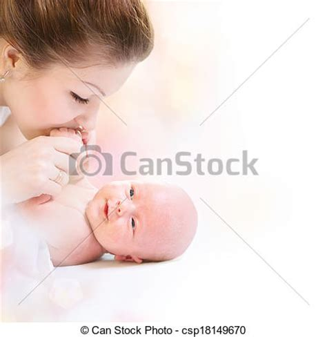 picture of newborn baby. happy mother and baby kissing and