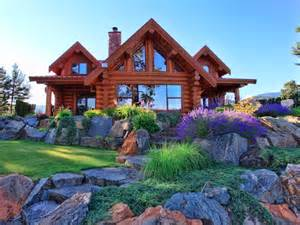 Completed custom log homes and cabins hand crafted canadian quality