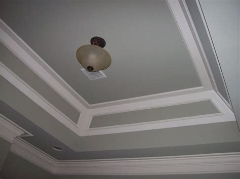 layered tray ceiling in 2 paint colors to match wall and trim work done by woodmaster woodworks