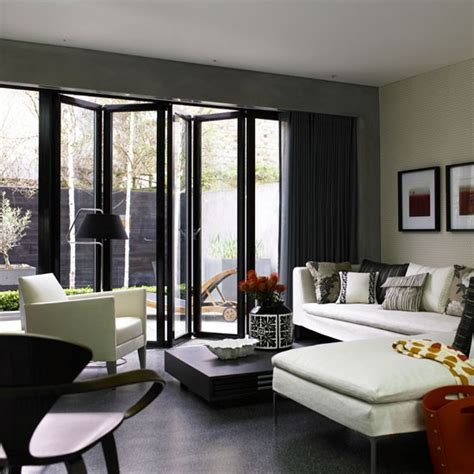 Contemporary Living Room Doors Use Folding Doors To Extend The Space Family Living Room