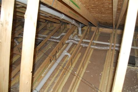 Ceiling Gypsum Board Installation by Ducts Buried In Attic Insulation And Encapsulated