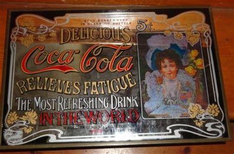 bid or bay advertising a vintage coca cola mirror with