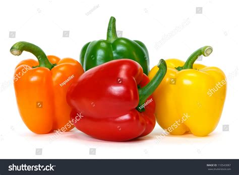 colored peppers colored peppers over white background stock photo