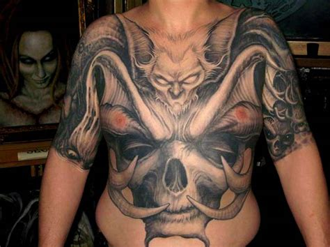 paul booth tattoos bat with horned skulll chest and stomach by