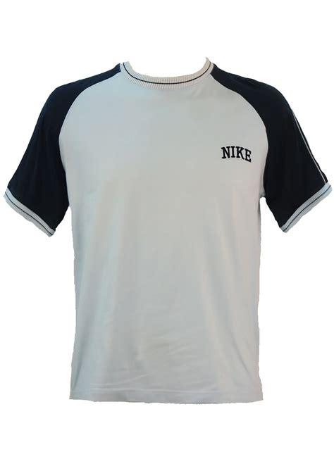 light blue nike t shirt with navy blue sleeve m