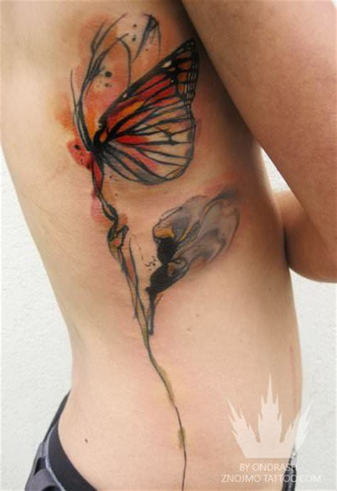 a butterfly clings to a flower stem in this watercolor