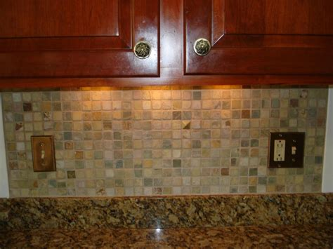 Pictures Of Kitchen Tile Backsplash by Stone Mossaic Backsplash With Metal Decos New Jersey