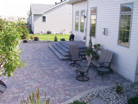 Patio Filler by Gray Paver Patio With Edging Rocks And Plants Oasis