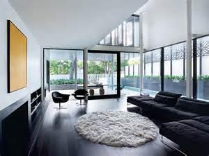Black Modern Modern Home With Black Sofa And Wood Flooring