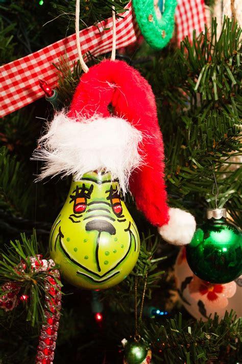 grinch light bulb ornament   etsy