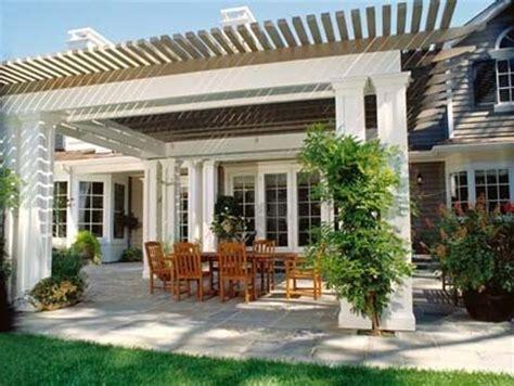 pergola and stone patio large pergola off back of house
