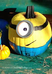 decorating and painting minion pumpkins for