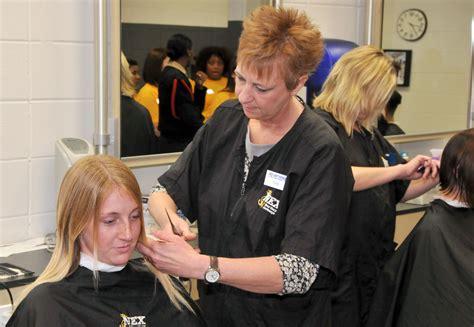 File:Pam Kiesgen, right, cuts the hair of U.S. Navy recruit Chelsea Murphy inside the Golden 13
