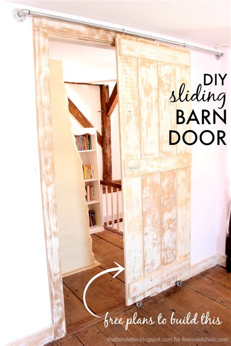 How To Hang Barn Door Remodelaholic Diy Sliding Barn Door Inexpensive Hardware