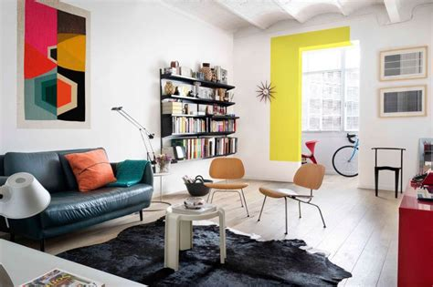 furnished living rooms colorful apartment with a white backdrop and eclectic artwork