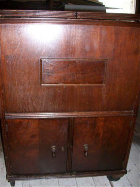 antique pop out liquor cabinet bar with cooler