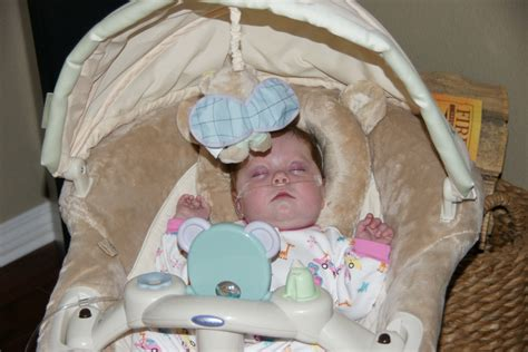 baby napping in swing heart of grace grace at home pictures