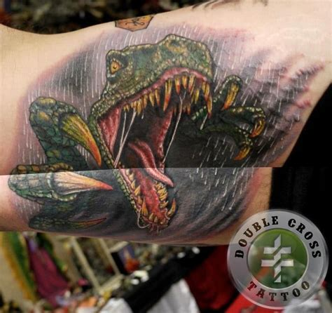 ft lauderdale tattoo dinosaur done by photelo at cross