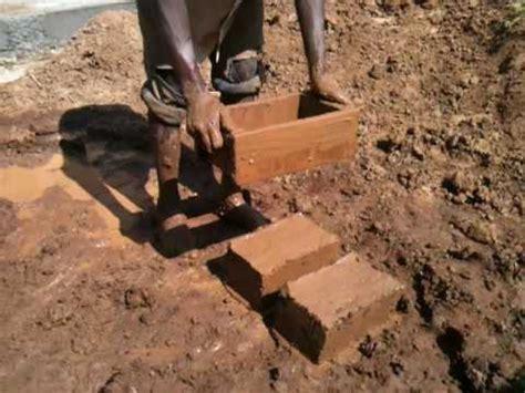 making mud bricks  rwanda youtube