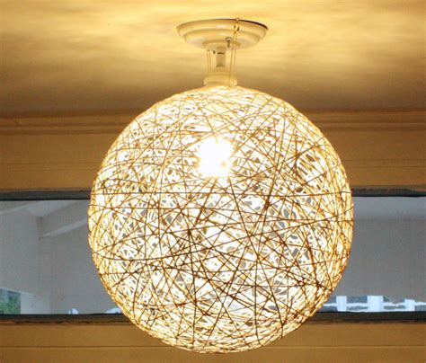 always wondered how you changed the light globes for those flush to mirror light fixtures diy string globe shade mint