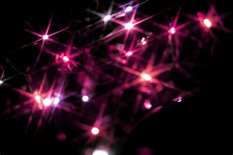 Photo Of Christmas Background Of Pink Starburst Lights Pink Lights
