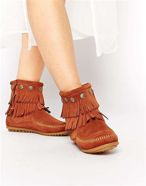 minnetonka boots for lyst minnetonka fringe coin detail boots in brown