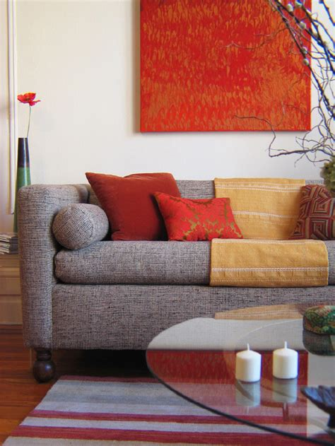 red and orange living room decorating with warm rich colors designers room and