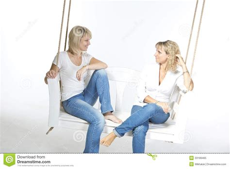 friends swinging two women talking to each other seriously pictures to pin
