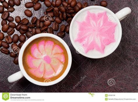 beautiful coffee two cups of beautiful coffee art cappuccino stock photo