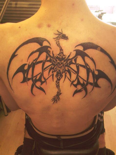 dragon tattoo at the back tribal dragon back tattoo by rossmowgli on deviantart