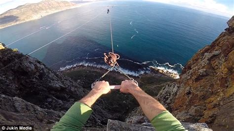 swinging experience project daredevil somersaults from cliff top using swingrope