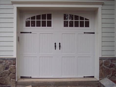 All You Need To Know About Garage Door Spring Replacement Garage Doors Carriage House Style