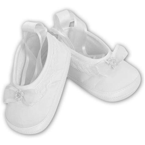white christening shoes for a baby